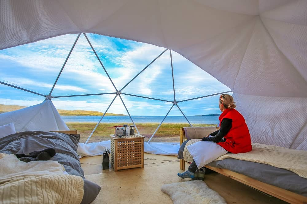 Two beds inside a glamping tent