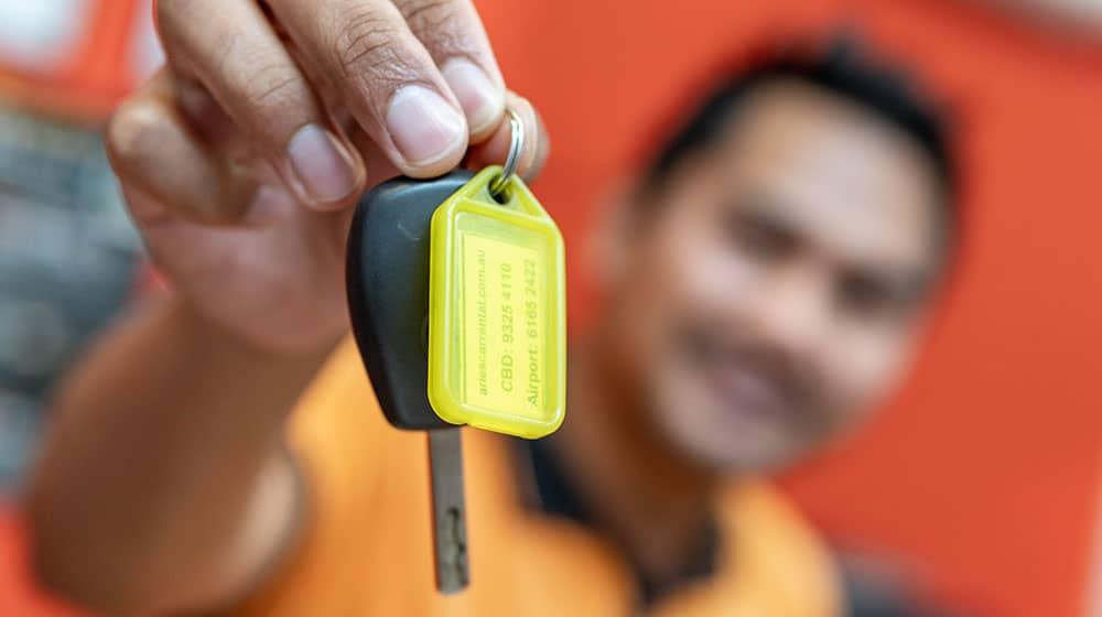Handing customer car keys